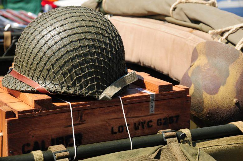 An army helmet atop an ammunition crate