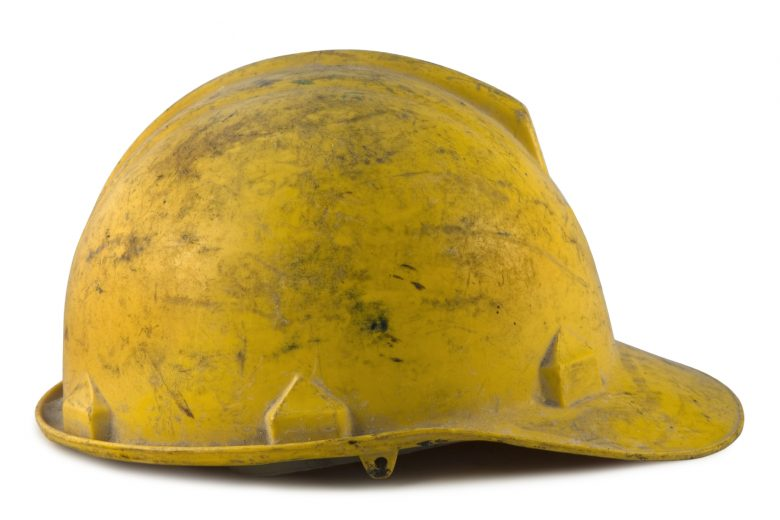 A dirty, yellow hardhat