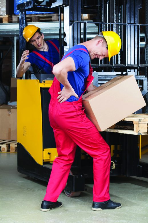 A worker hurts his back on the job while manually carrying a box