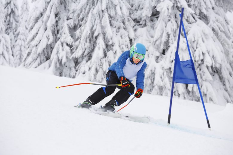 A young downhill skier