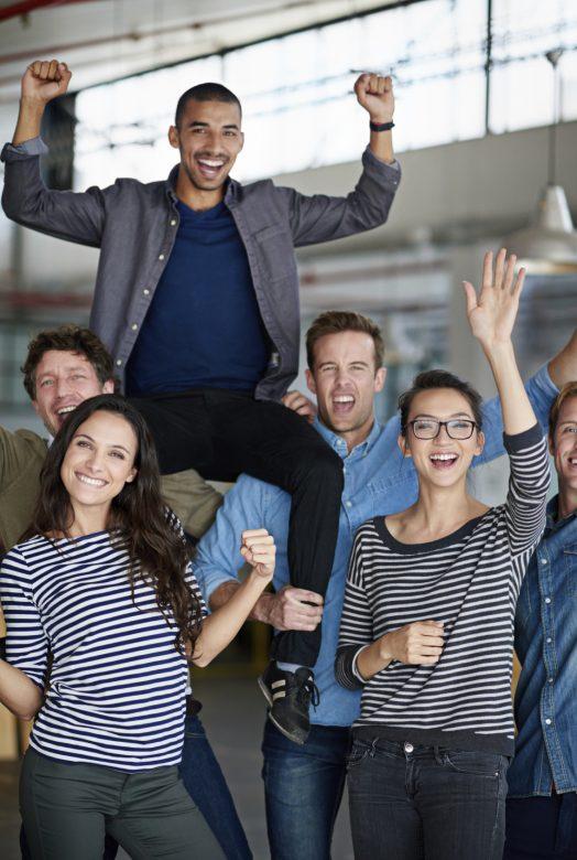 Motivated people celebrate a success