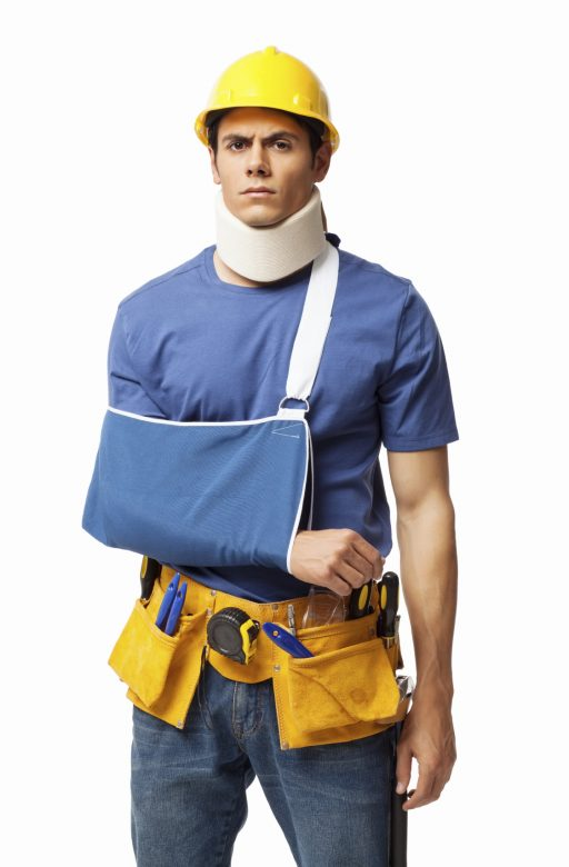 A young construction worker with a cast on his arm from an injury
