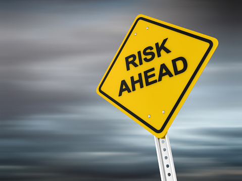 Risk displayed in a yellow safety warning sign