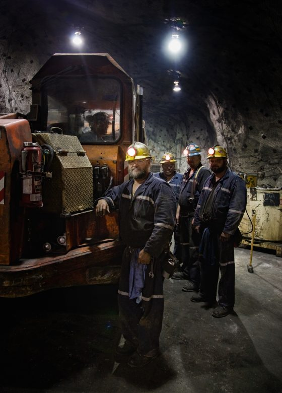 Zinc miners with a 40-ton mine truck, shot at 3100 feet below the surface in the truck maintenance room