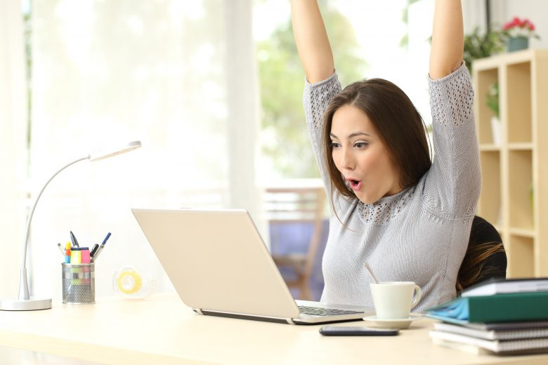 Young woman excited about winning online