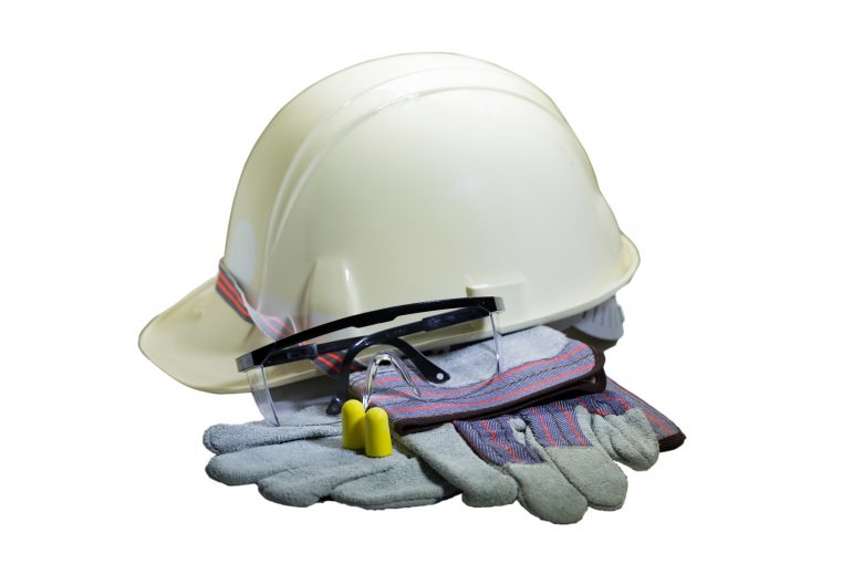 Assorted collection of PPE including hardhat, gloves, safety glasses and ear protection.