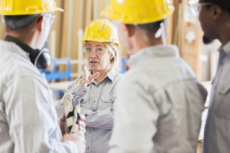 Woman delivering a safety talk on a construction site