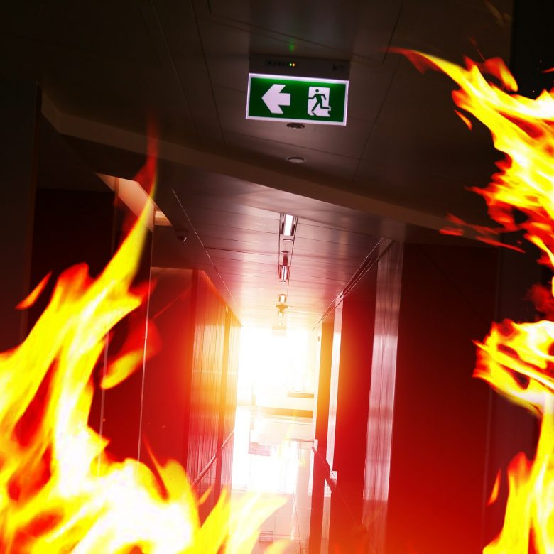 Fire in an office building with the fire exit in sight