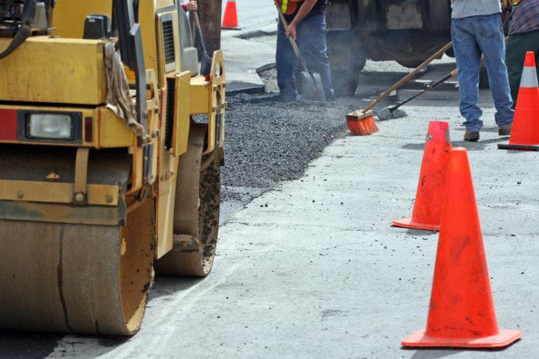Hot asphalt road work in the hot sun