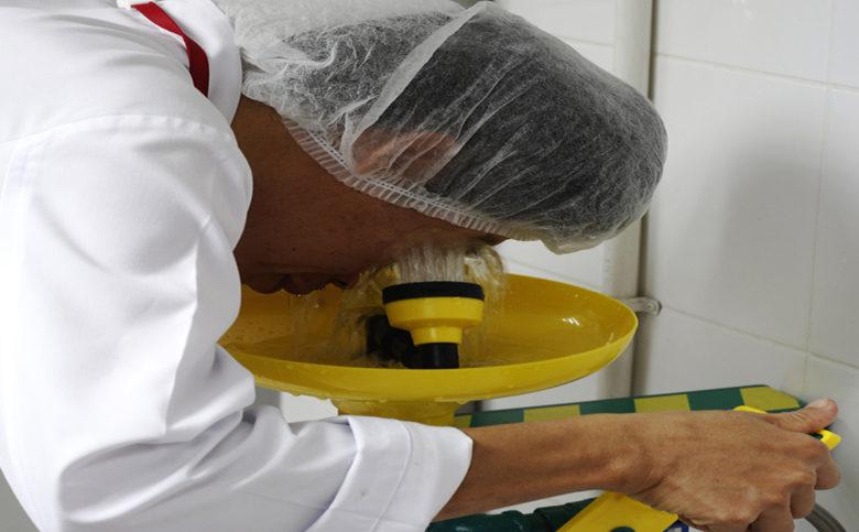 worker is using eyewash station