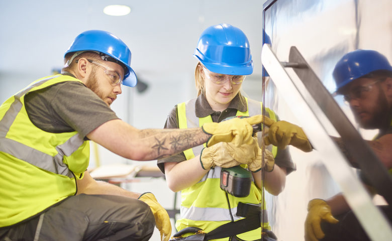 Young worker learning how to perform job safely