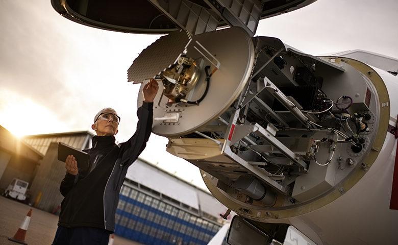 Aircraft mechanic working on an airplane