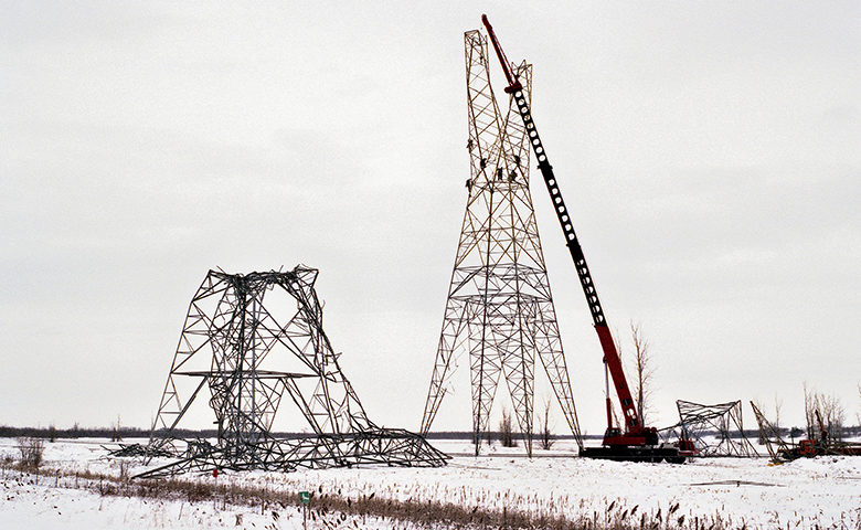 Fallen hydro towers, under reconstruction after the famous 1998 ice storm, in eastern Canada.