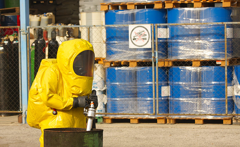 Collecting hazardous material in hazmat suit