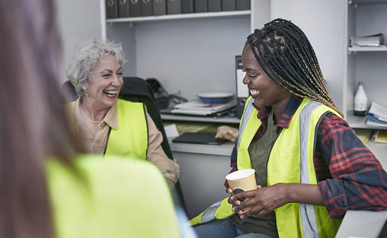 Female workers laughing showing engagement in a good company culture
