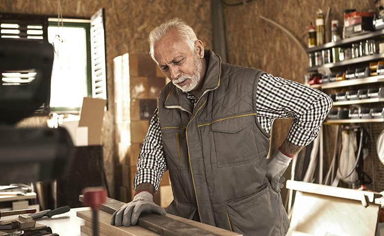 Senior carpenter having back pain