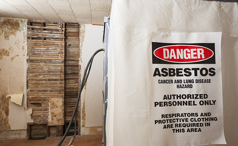 Asbestos Warning Danger Sign on a Decontamination Chamber