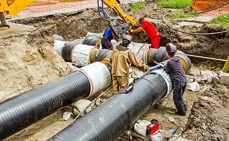 Team of contractors on building new pipeline