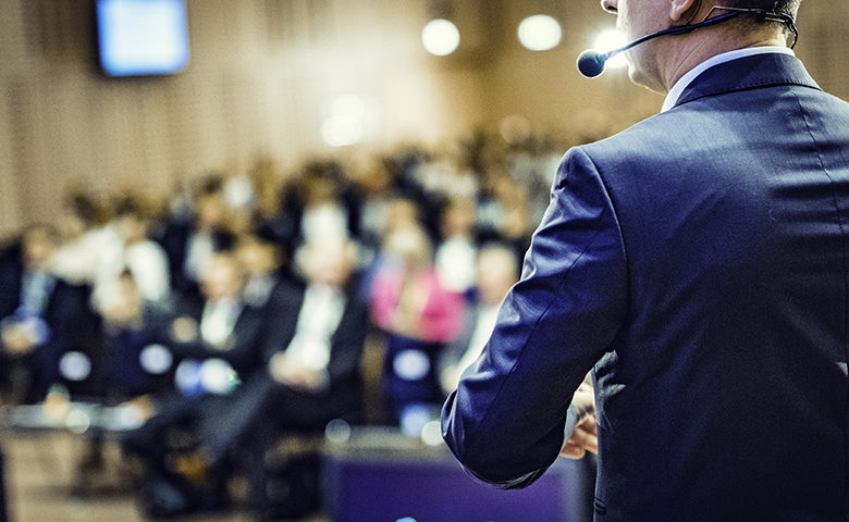 Rear view of a speaker at a conference