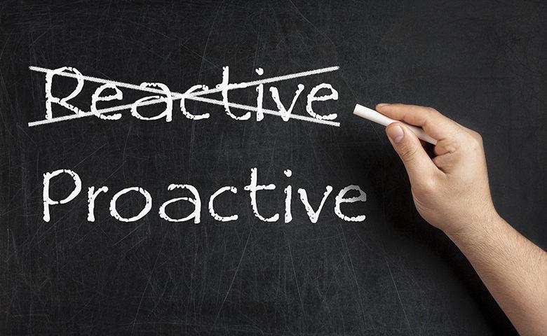 Being Proactive not Reactive crossed blackboard chalkboard