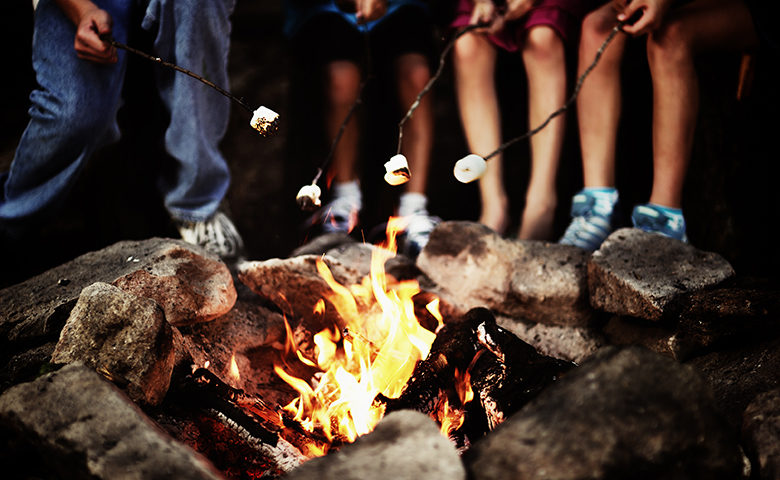 Roasting marshmallows around the campfire