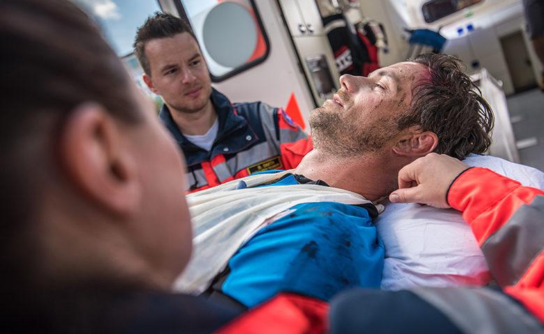 Paramedic team attending serious injury