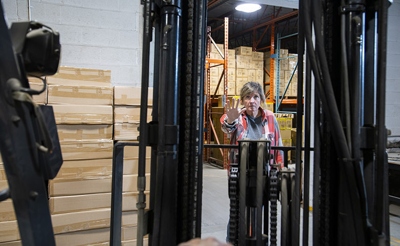 A warehouse and logistics safety topic. A close call. A forklift driver almost colliding with a pedestrian.