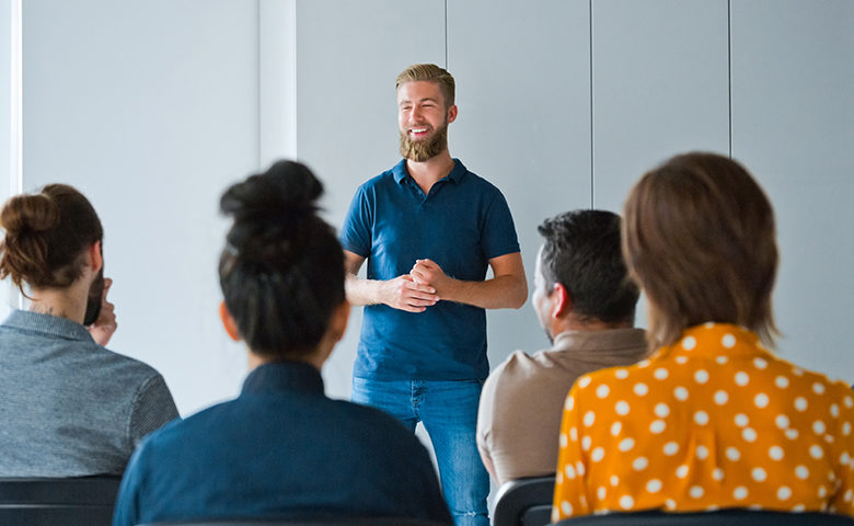 Man delivering toolbox talk to small group