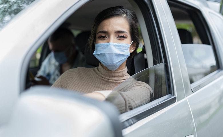 Driving during pandemic with mask on