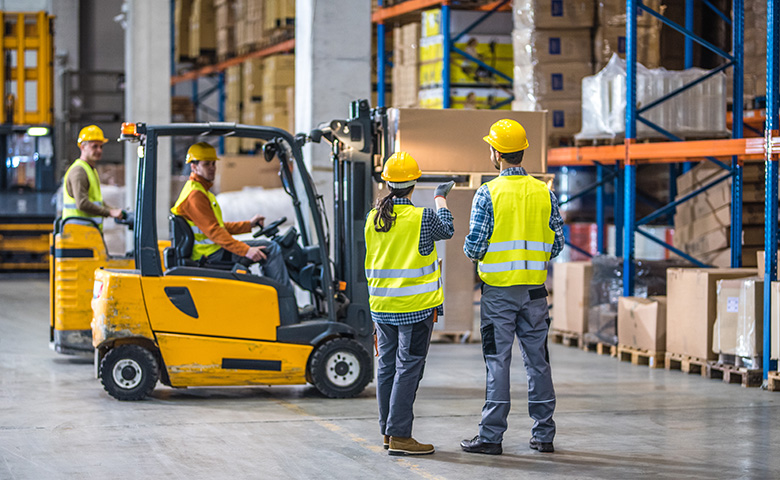 Forklift working in warehouse