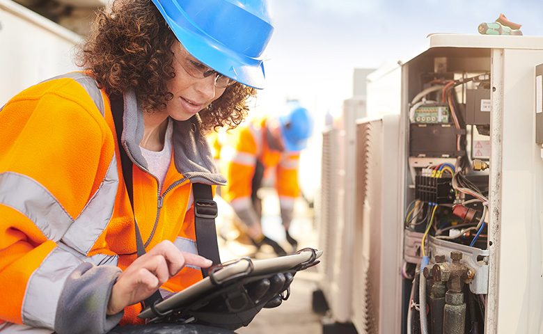 female electrician with aircon unit